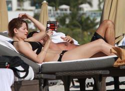 http://img25.imagevenue.com/loc518/th_312960155_T0XT5R8LTY_Mischa_Barton_Wearing_a_Bikini_in_Miami021_122_518lo.jpg